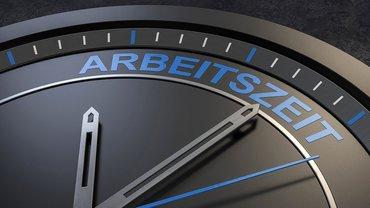 Bild zeigt Uhrzeiger die auf das Wort Arbeitszeit zeigen